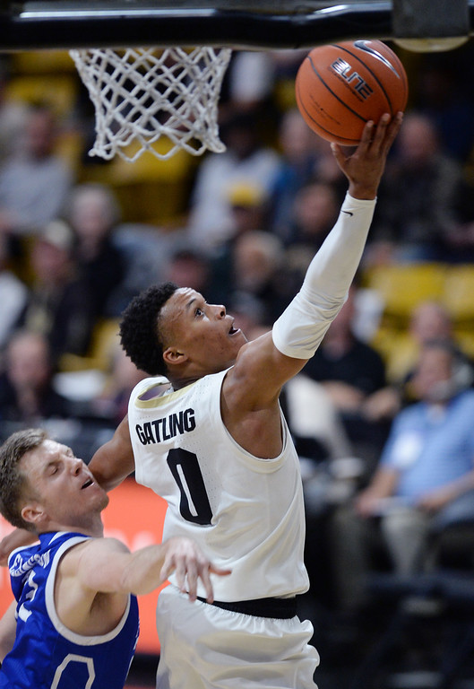 . BOULDER, CO: November 13:University of Colorado\'s Shane Gatling  drives to the basket during the game with the Drake Bulldogs. (Photo by Cliff Grassmick/Staff Photographer)
