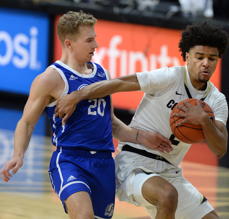 . BOULDER, CO: November 13: University of Colorado\'s Daylen Kountz, right, drives on Drake\'s Nick Norton during the game with the Drake Bulldogs. (Photo by Cliff Grassmick/Staff Photographer)