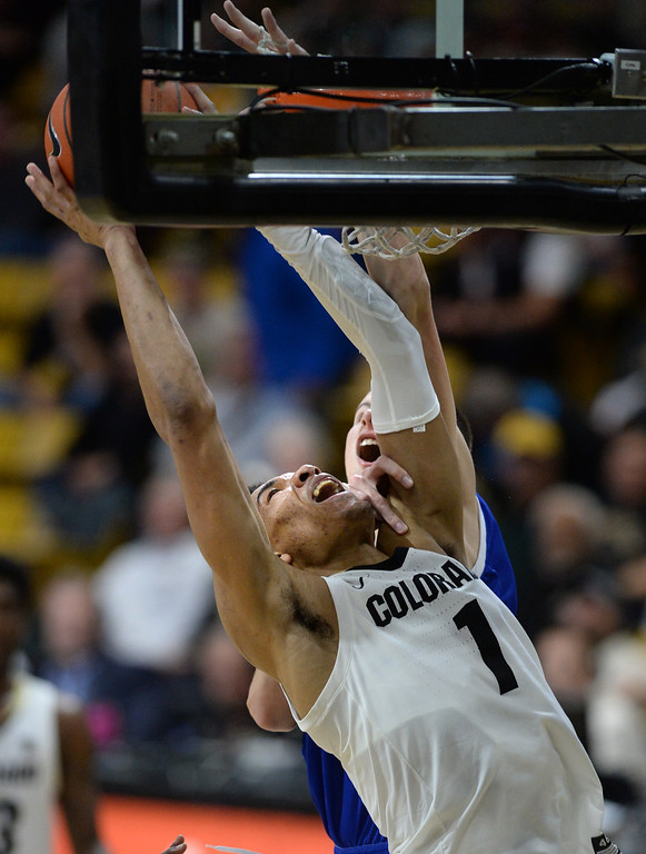 . BOULDER, CO: November 13: Colorado\'s Tyler Bey goes strong tp the basket during the game with the Drake Bulldogs. (Photo by Cliff Grassmick/Staff Photographer)