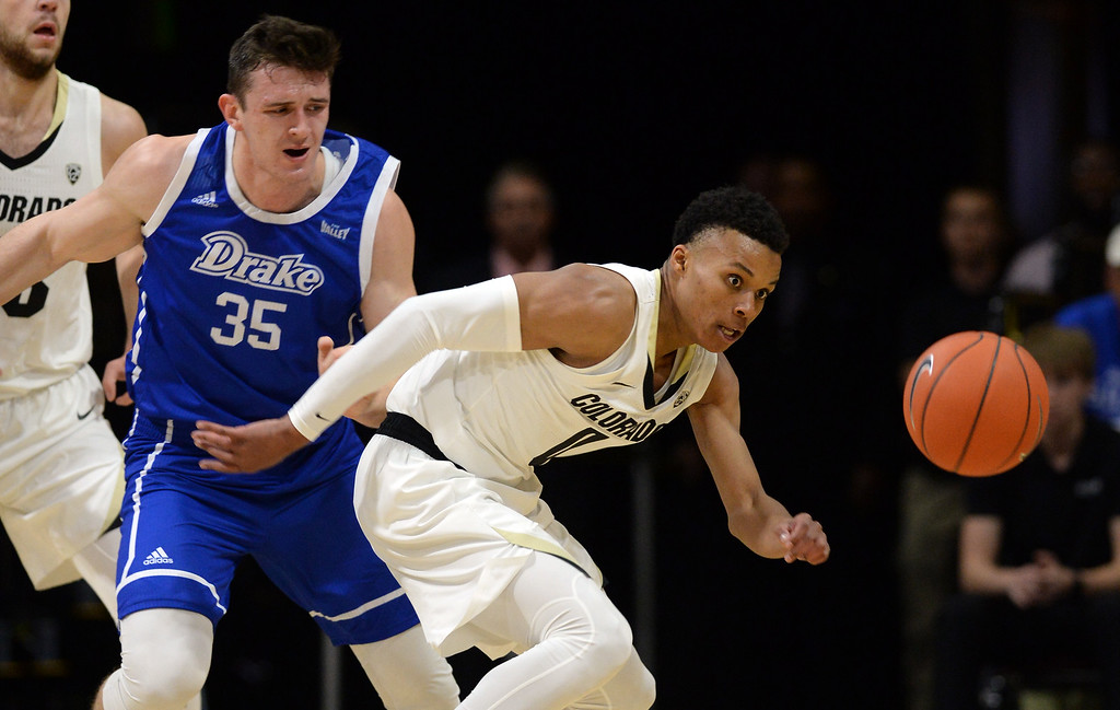 . BOULDER, CO: November 13: University of Colorado\'s Shane Gatling, right, knocks the ball from Drake\'s Nick McGlynn during the game with the Drake Bulldogs. (Photo by Cliff Grassmick/Staff Photographer)
