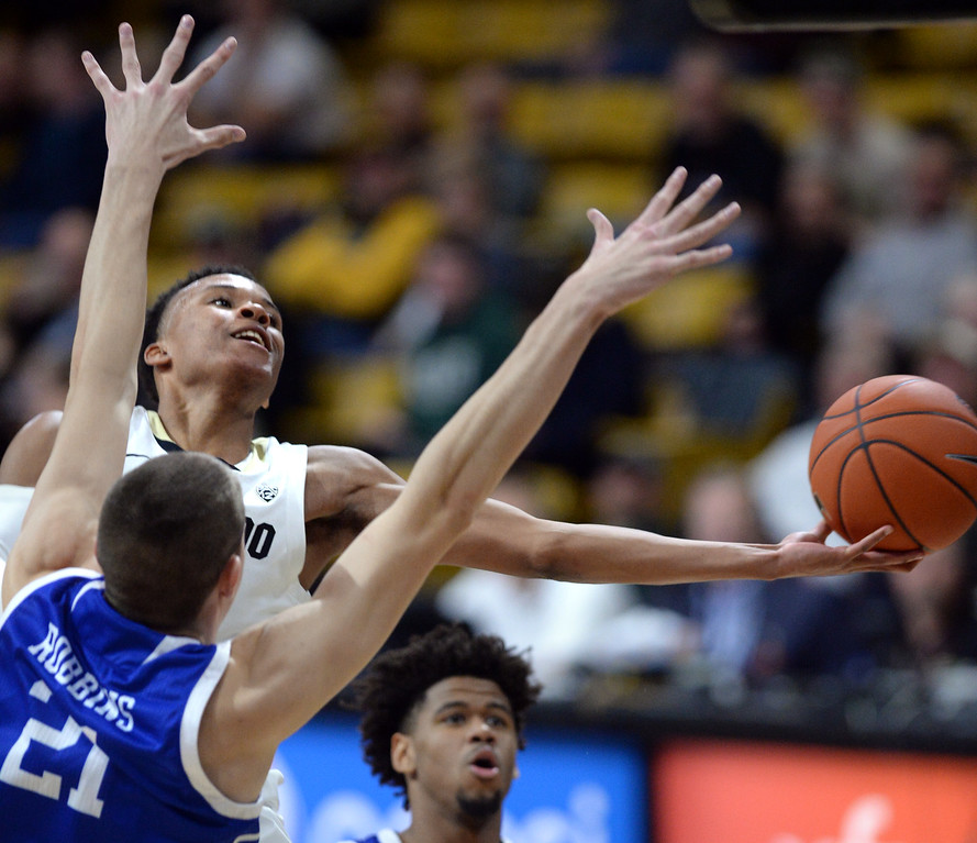 . BOULDER, CO: November 13:  University of Colorado\'s Shane Gatling stretches out for a layup Drake\'s Liam Robbins during the game with the Drake Bulldogs. (Photo by Cliff Grassmick/Staff Photographer)
