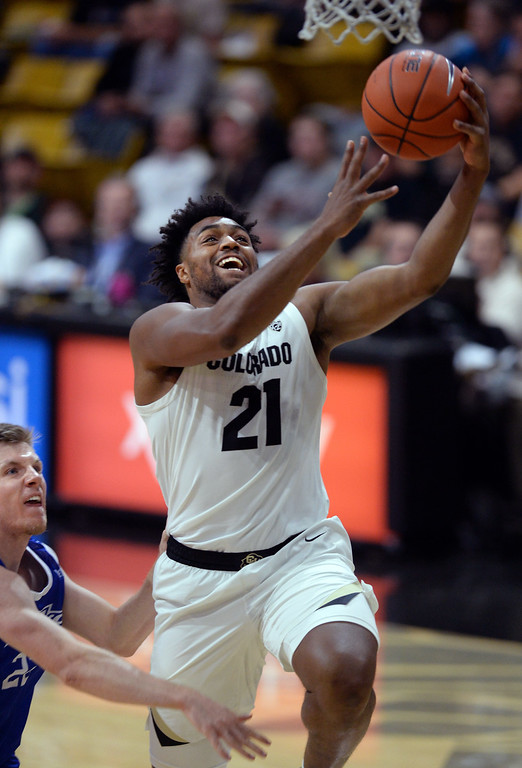 . BOULDER, CO: November 13: Colorado\'s Evan Battey drives to the basket during the game with the Drake Bulldogs. (Photo by Cliff Grassmick/Staff Photographer)