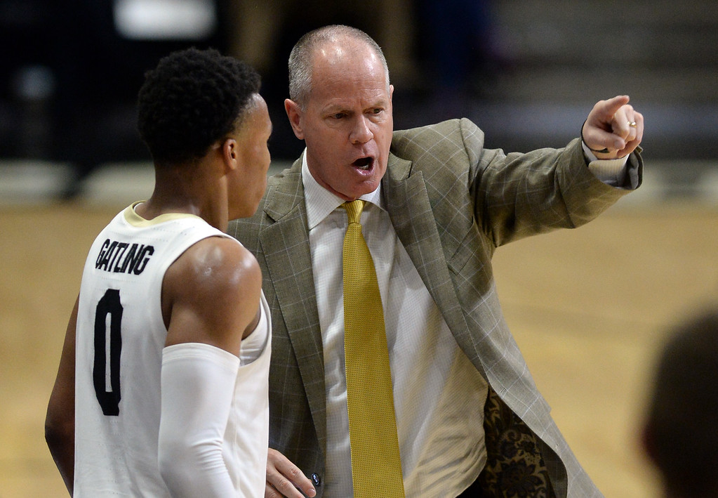 . BOULDER, CO: November 13: University of Colorado\'s head coach, Tad Boyle, right, talks to Shane Gatling during the game with the Drake Bulldogs. (Photo by Cliff Grassmick/Staff Photographer)
