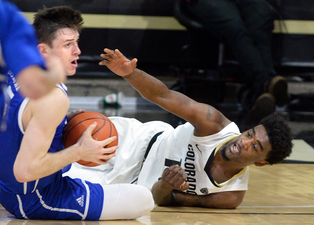 . BOULDER, CO: November 13: University of Colorado\'s Namon Wright, right, struggles for the ball with Drake\'s Connor Gholoson during the game with the Drake Bulldogs. (Photo by Cliff Grassmick/Staff Photographer)