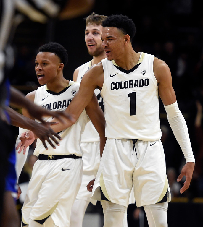 . BOULDER, CO: November 13: University of Colorado\'s  Shane Gatling, left, Lucas Siewert, and Tyler Bey, congratulate McKinley Wright IV after a basket during the game with the Drake Bulldogs. (Photo by Cliff Grassmick/Staff Photographer)