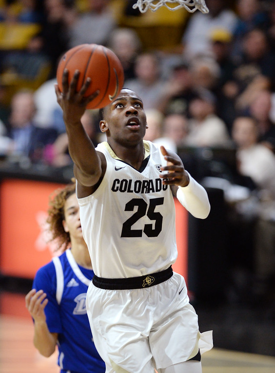 . BOULDER, CO: November 13: University of Colorado\'s McKinley Wright IV, drives past Drake\'s Noah Thomas during the game with the Drake Bulldogs. (Photo by Cliff Grassmick/Staff Photographer)