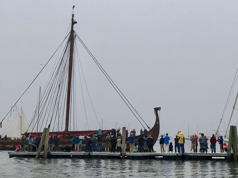 People gather on the Rockland Public Landing to great the Draken as it arrives on Sunday July 22, 2018.