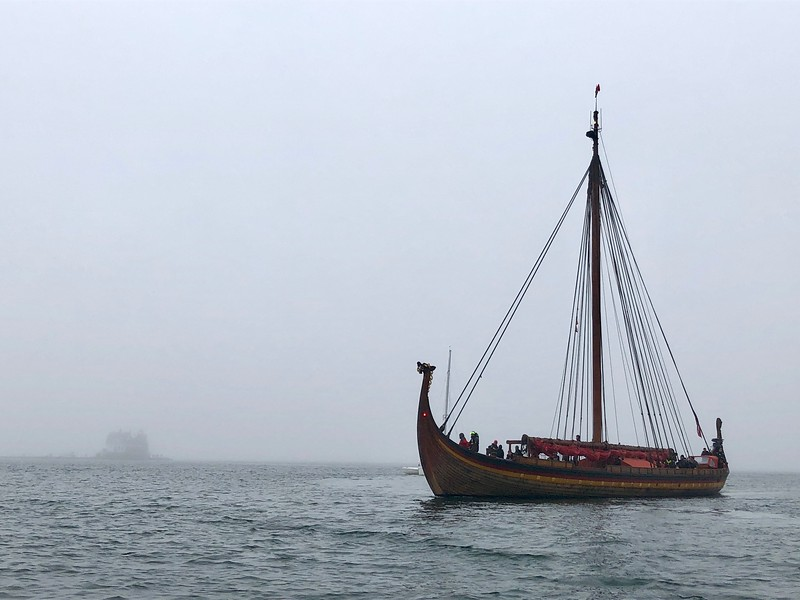 The Draken Harald Harfagre passes by the Rockland Harbor Breakwater Light in the fog.