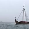 The Draken Harald Harfagre passes by the Rockland Harbor Breakwater Light in the fog.