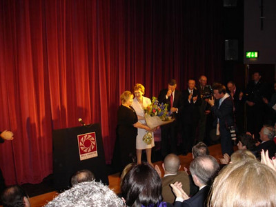 Karen presenting flowers to Mary McAleese. Mill Theatre 06.