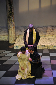 Friar Lawrence played by Michael Sharp with Juliet (Eilis O'Brien) and Romeo (Robert Hudson)