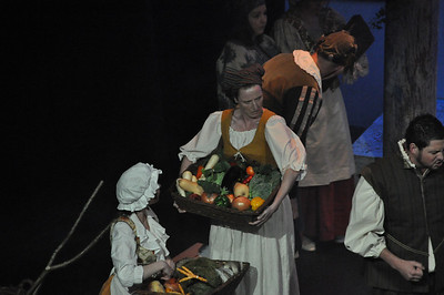 A stern look from Claire O'Donovan playing a Citizen, with a very large basket of vegetables, while Jamie McLoughlin (right) is in fighting form.