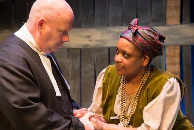 Brian Molloy (Reverend Hale) and Eleanor Phiri (Tituba)