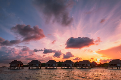 Maldivian water bungalows at sunrise
