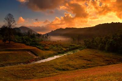 Sunrise over mountain range at Pang-Ung