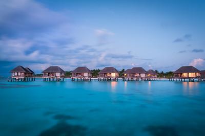Maldivian water bungalows at dusk