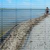 A lone man walking on a beach
