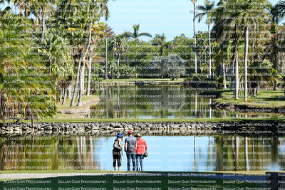 Tourists enjoy the stunning beauty at Fairchild Tropical Botanical Gardens in Miami, Florida.  Fairchild is a world premier tropical garden with the largest collection of palm and cycads in 83 acres.