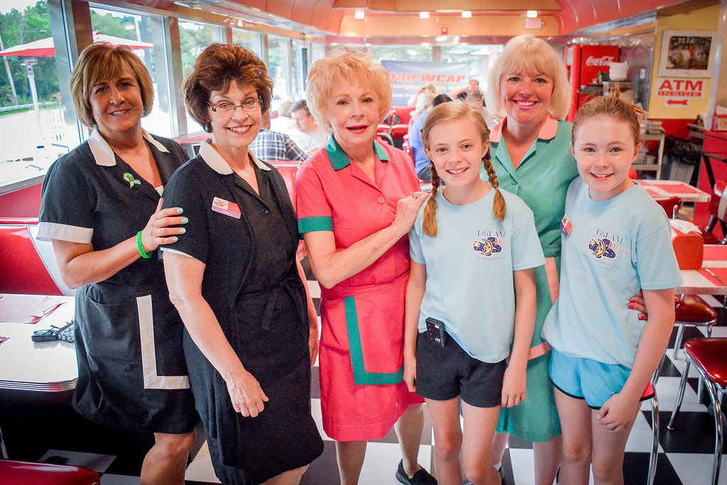 . A group photo of some of the Dream Diner crew, from left, Doreen McGloughlin of Tewksbury, Mary McAnistan of Tyngsboro, Bridget Trepsas, mother of owner Marybeth Shanahan, and Marybeth\'s daughters, Molly, 11, and Mya, 12. SUN/Caley McGuane