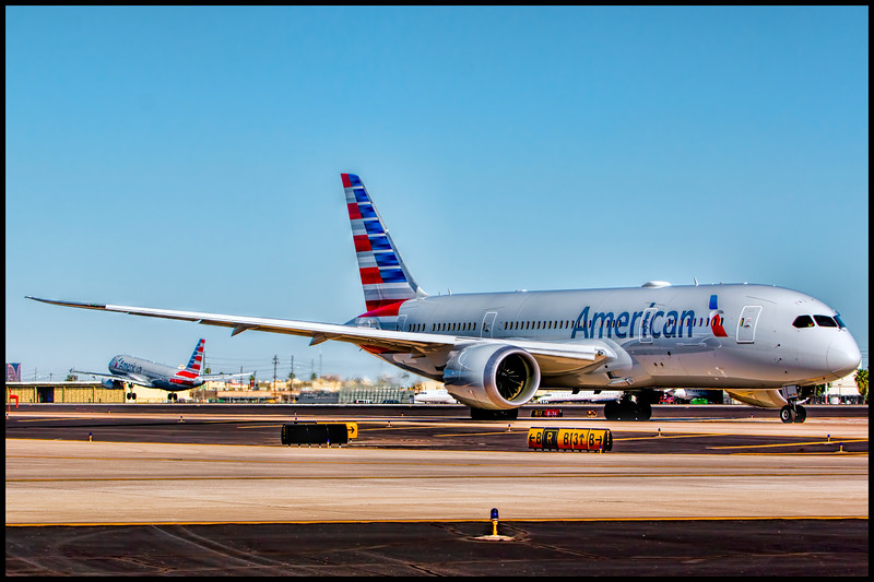 Boenig 787 Readies for Departure while Airbus A321 Arrives