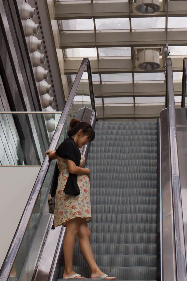 Raimondo Sarich's Pregnant Lady Ascending Escalator, 2011