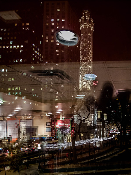 Reflections of Chicago Water Tower around the holidays.