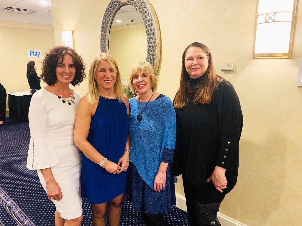. Habitat�s Dream beauties, from left, Kim Trainor, Executive Director Brenda Gould, Lisa Garvey and Heidi Tierney, all of Westford