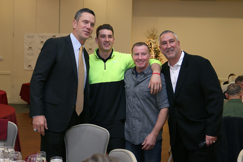 Former Patriots quarterback Drew Bledsoe was at Four Oaks in Dracut for a wine-tasting and a fundraiser for the Salvation Army on Thursday night. Posing with him is Michael Kuenzler Jr. from Dracut, Micky Ward from Lowell, and owner of Four Oaks Michael Kuenzler Sr. SUN/JOHN LOVE
