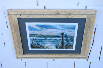 "A print entitled ""Solitary Surf, Dominion"" presumably of a rough day @ Dominion Beach near Sydney, NS.  Note some of the insect add 'character' in the wood with the pitting and burrowing within the wood often really adds an interesting element and flair similar to say, 'Birds Eye Maple""."