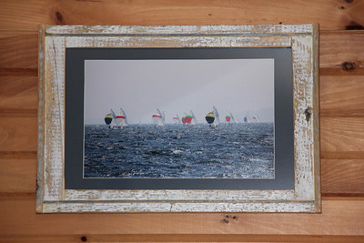 This 420 fleet of dinghy's captured from the water and framed in this rustic, found and slightly polished all driftwood piece sold at North Sails Atlantic, Halifax, NS.