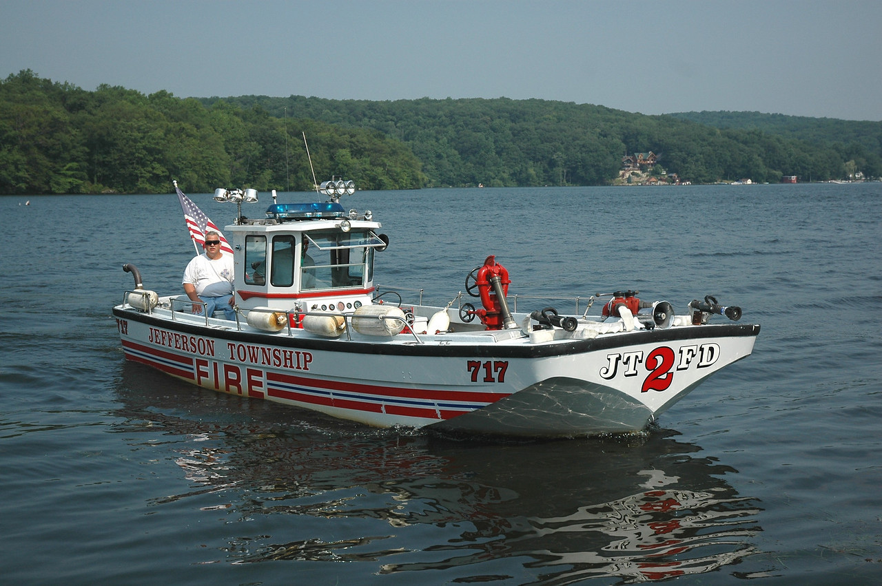 Jefferson Twp Fire Co#2 of Lake Hopatcong, New Jersey  FIRE BOAT 717 (DEFENDER)  29 ft long 7 1/2  ft wide. The Front  has (2) 50ft  pre- connects off a gated wye  a 4 inch Monitor (DECK GUN) w/ Straight tip and adjustable Nozzle, (2) 3 inch rear discharges  It is powered by (2) GM  455 HP Corvette engines. 1 for power train  the other for the pump, It can deliver over 1500 Gallons Per Minute The boat coveres over  10 miles of water front property in four towns on the state's Largest Lake in  New Jersey