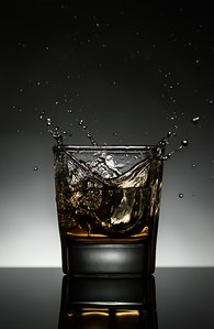 splashing whiskey with ice cubes