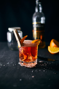 Alcoholic Cocktail With Orange Peel And Ice..
