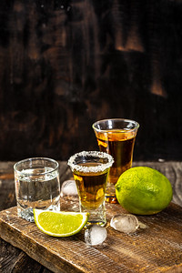Alcoholic Drink Concept. Mexican Tequila With Lime And Salt On Rustic Wood Background. Space For Tex