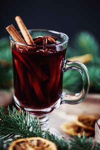 Christmas hot mulled wine in a glass with spices and citrus fruit. Mulled wine with cinnamon, anise and orange