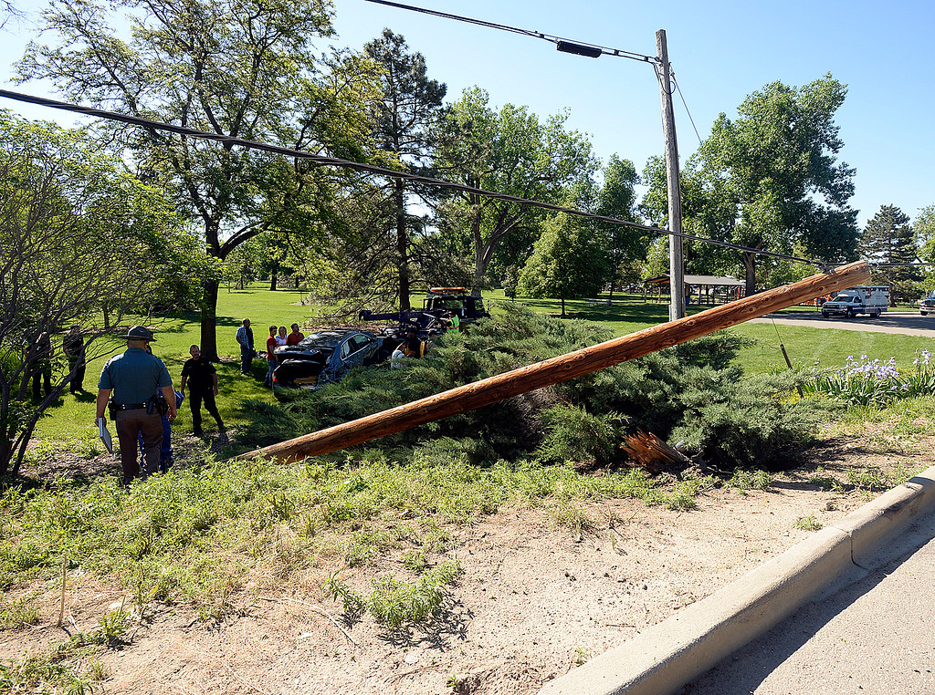 . A power pole was sheared off near the base when a teen driver hit the pole Wednesday, May 30, 2018, before ending up in the Big Thompson River on Namaqua Road in west Loveland. The driver was not injured in the accident.  (Photo by Jenny Sparks/Loveland Reporter-Herald)
