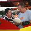 FORMER BIG BLOCK MODIFIED DRIVER RICKY ELLIOT AND A CREW MEMBER LOOK OVER SOME NOTES
