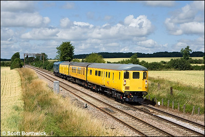 DBSO 9702 is propelled by 31106 approaching Rushton whilst working 4Z03 1010 Derby RTC-Selhurst T&RSMD on 13/07/2009.