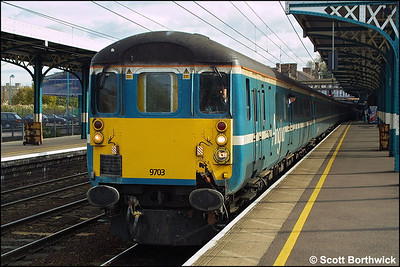 9703 awaits the 'off' at Ipswich on 25/10/2003 whilst leading 1P20 1130 London Liverpool Street-Norwich propelled by 86250.
