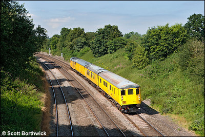 DBSO 9702 is propelled down Hatton bank by 31285 whilst forming 3Z80 0852 Derby RTC-Eastleigh Alstom Down Sdg on 09/08/2012.