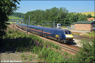 82205 passes Granthouse whilst leading 1E11 1200 Edinburgh Waverley-London Kings Cross propelled by 91117 on 14/07/2003.