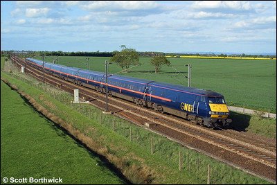 82220 propelled by 91107 heads for London Kings Cross at Colton Junction, York on 07/05/2003.