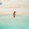 Sunbathing in paradise beach at Moho Caye, Belize