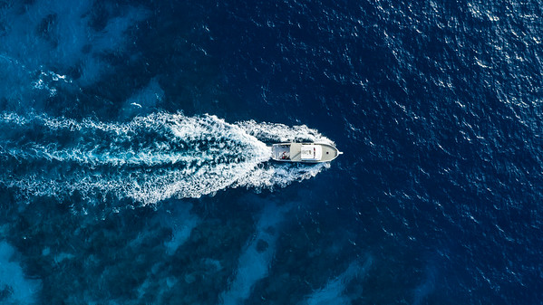 Aerial drone view of boat at Blackbird Caye at Turneffe Atoll in Belize