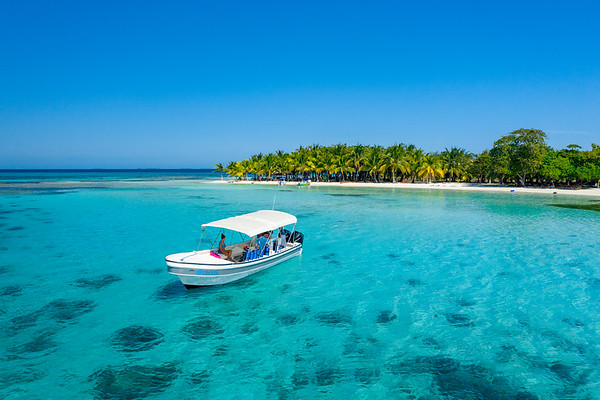 Aerial Drone view of boat at Moho Caye, Belize