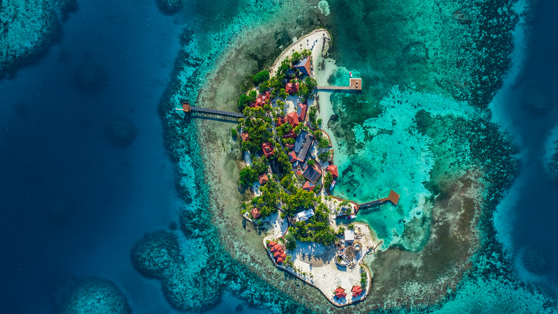Aerial drone view of Ray Caye Island Resort, Belize
