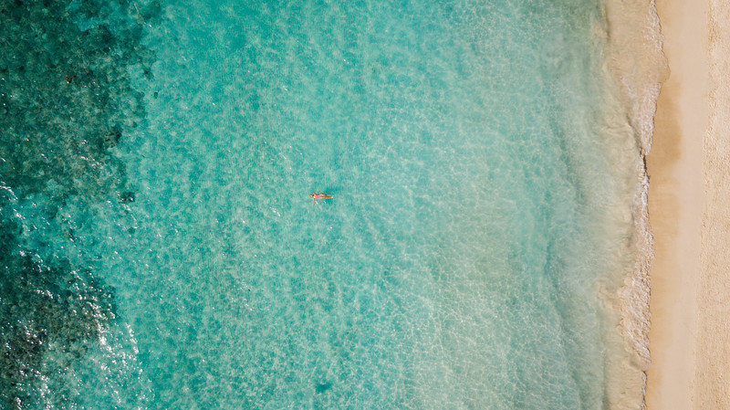 Girl chilling in the water at Infinity Bay Resort in Roatan, Honduras