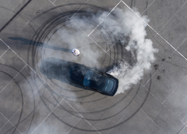 Stunt driver Paul Swift doughnuts a Mustang around a willing victim