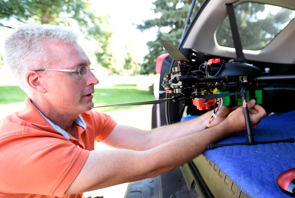 . LONGMONT, CO - AUGUST 9:  Tim Haynie, of Arbor Drone, prepares the craft for flight.  Arbor Drone LLC and Spectrabotics LLC,  collected data using drone flights over northwest Longmont on August 9, 2018, to study and monitor trees affected by Emerald Ash Borer (EAB).  Longmont will be one of the last EAB detection flights for 2018 for the team. Drone flights in urban areas to study tree pests have never been conducted at this scale. (Photo by Cliff Grassmick/Staff Photographer)