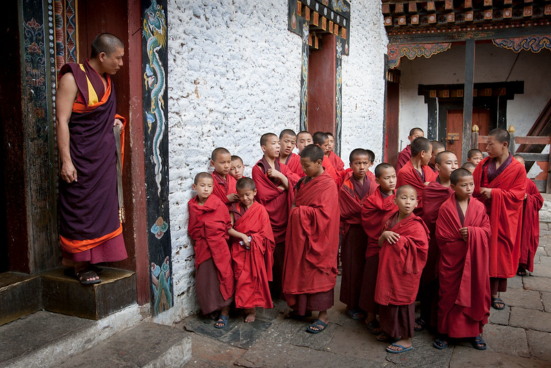 Novice monks and teacher. Trashigang Dzong.